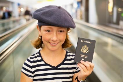 Girl holding passport in airport