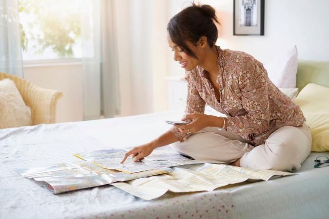 Woman looking at map planning trip