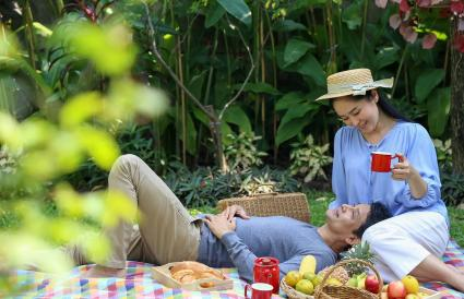 Couple Enjoying Weekend At Back Yard