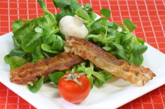 vegan bacon sitting on a salad