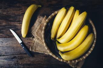 Bananas In Basket On Table