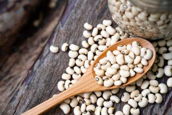 Soy beans on wooden spoon