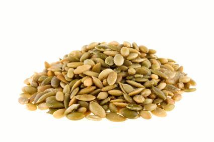 pile of raw pumpkin seeds