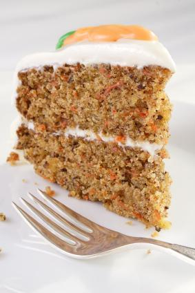 Slice of carrot cake with cream-cheese frosting.