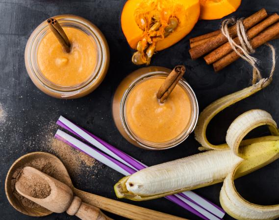 pumpkin spice smoothie surrounded by ingredients