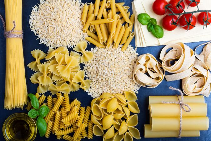 variety of pastas on blue background