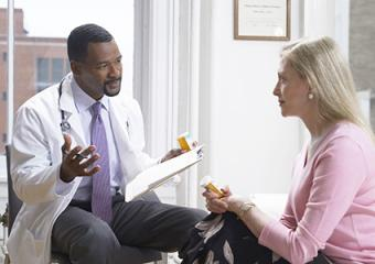 Doctor conferring with patient
