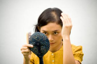 Woman looking at her scalp