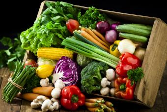 Wooden crate with fresh organic vegetables