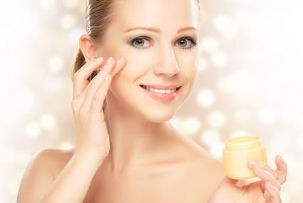 Woman using a face cream