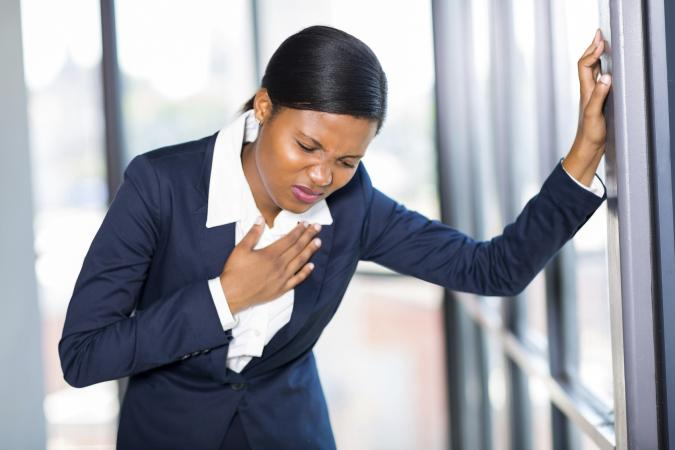 Woman having a hard time breathing