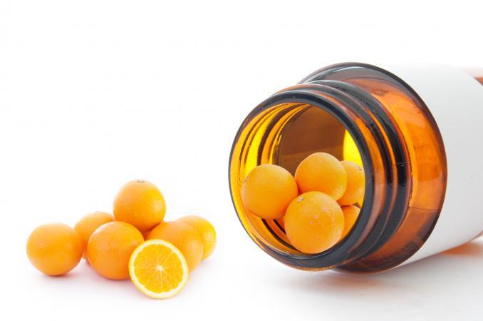 Oranges on medicine bottle representing vitamin c