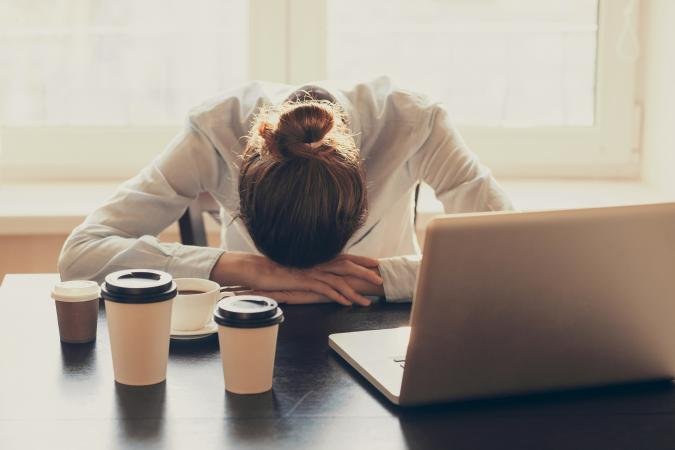 Exhausted woman at desk