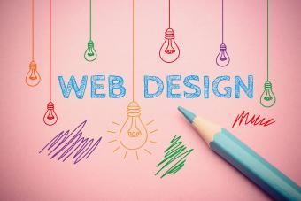 Web design words with blue pencil