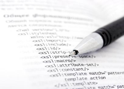page of XML with a pen