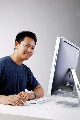 A web designer happy at his computer
