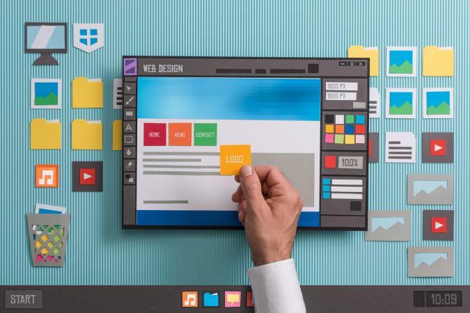 Hand placing component of website design