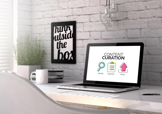 Laptop with content curation concept onscreen