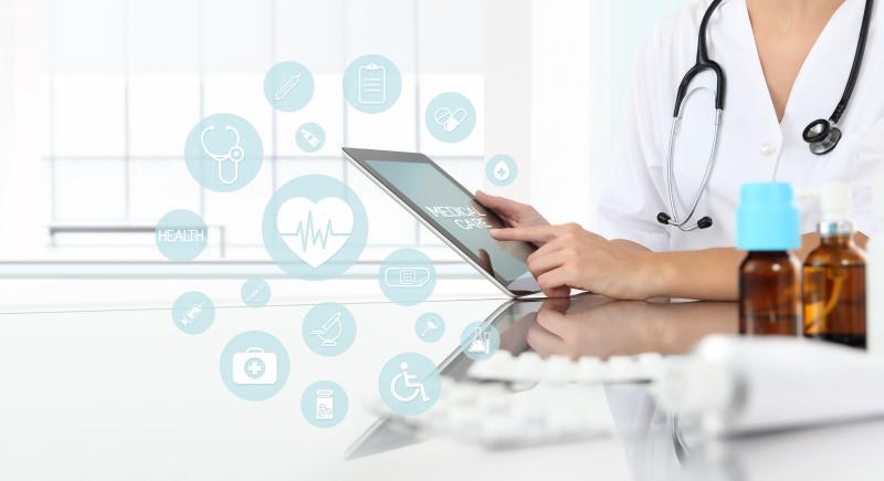 doctor accessing medical website on tablet