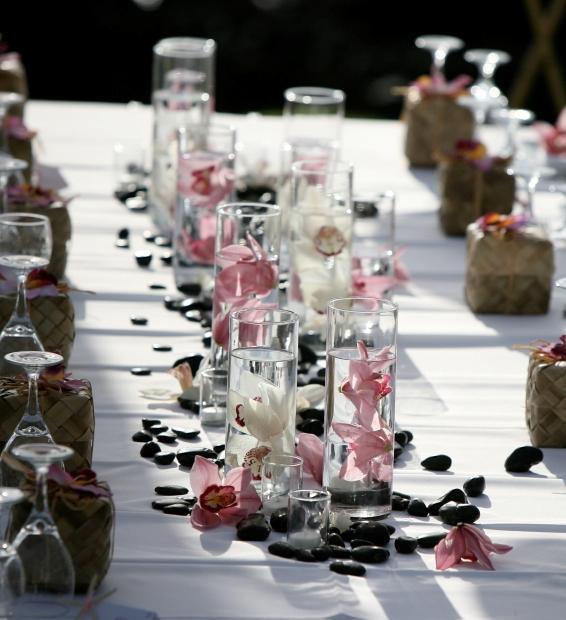 Ideas for wedding centerpieces lovetoknow stone and flower centerpiece junglespirit Images