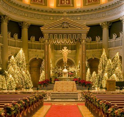 church decorated with lighted trees for a christmas wedding