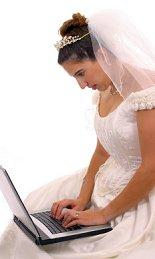 A bride typing her vows on a laptop
