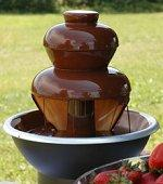 Chocolate fondue fountain at an outdoor wedding