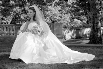 Outdoor portrait of a bride in a big dress