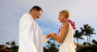 Couple renewing wedding vows in an intimate ceremony