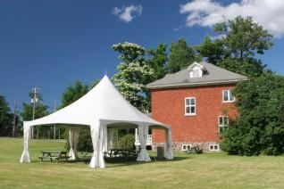 White tent set up for a small backyard reception