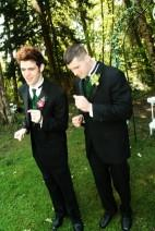 The groom and best man practicing dance moves