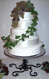 Elegant scroll base wedding cake stand