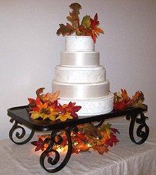 Black scroll iron wedding cake stand