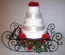 Photo of a sleigh-style iron cake stand