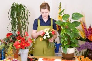 Florist assembling a wedding bouquet