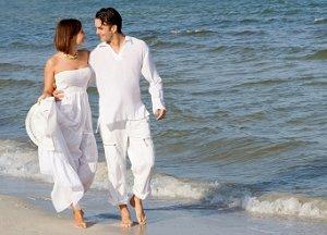 Couple in informal white clothes for a beach wedding