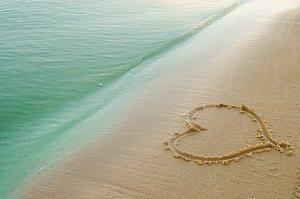 A heart drawn in sand at a beach