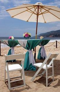 Turquoise and white beach wedding reception tables