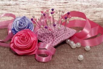 Pin cushion and ribbons for making satin roses