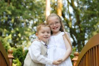 Boy in a spring suit and girl in spring dress