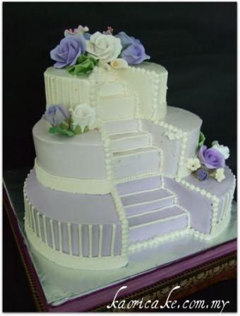 cake with stairs cut into tiers