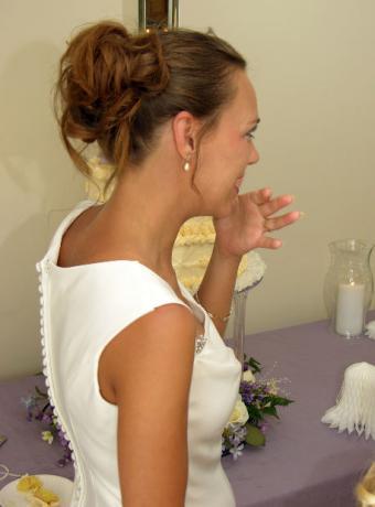 Bride tasting cake flavors