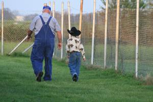 grandfather and child walking