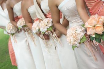 https://cf.ltkcdn.net/weddings/images/slide/106748-849x565-White_and_Coral_BM_Dresses.jpg