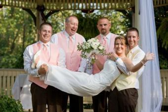 https://cf.ltkcdn.net/weddings/images/slide/139236-637x424r1-HoldingBride.jpg