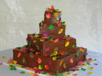 Chocolate spice wedding cake decorated with fall leaves