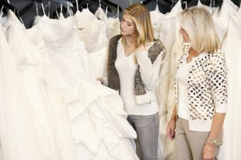 Mother and daughter shopping for bridal gowns
