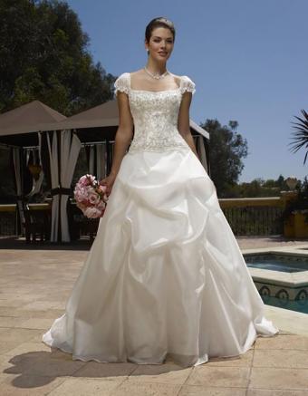 https://cf.ltkcdn.net/weddings/images/slide/176636-661x850-Casablanca-Dress-1903-doll-sleeves.jpg