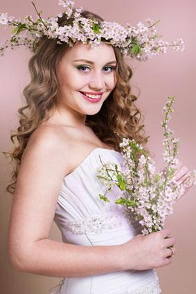 bride with cherry blossom wreath and bouquet