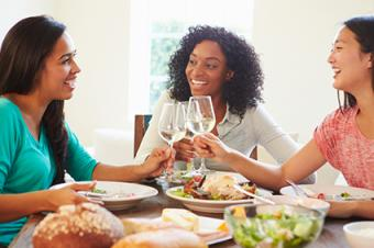 Girlfriends toasting wine glasses
